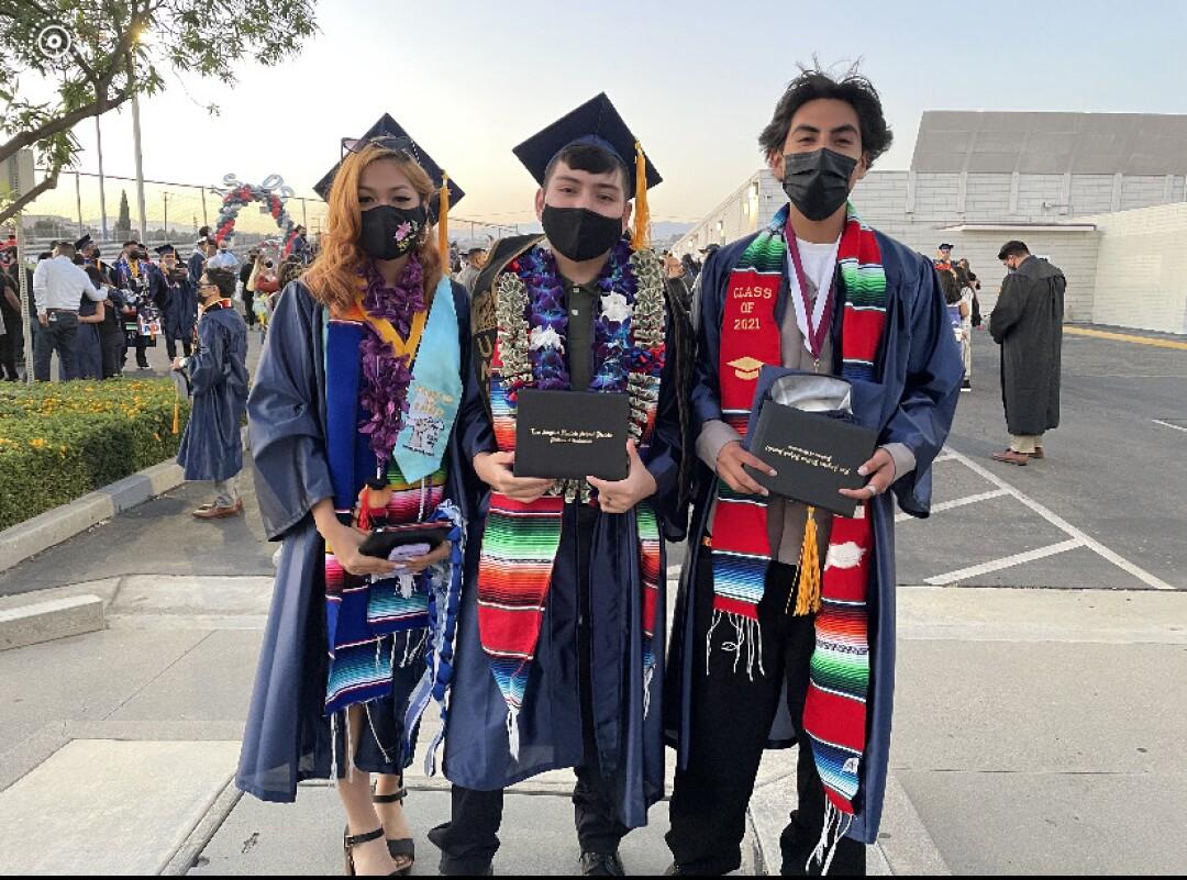 Joaquin Gonzalez, center, with his friends on graduation day at Garfield Senior High School.