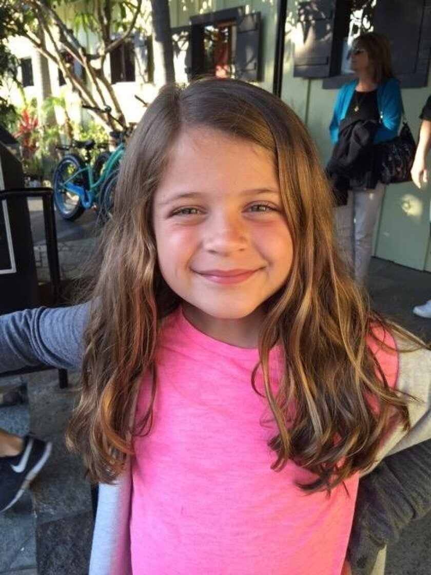 Six-year-old Ryder Perryman with her new short 'do.