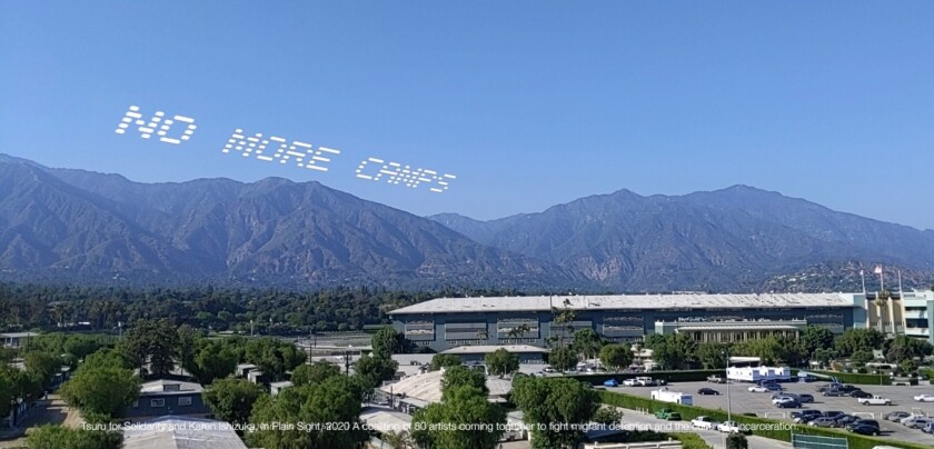 "An augmented reality visualization shows the words ""No more camps"" over Santa Anita Park."