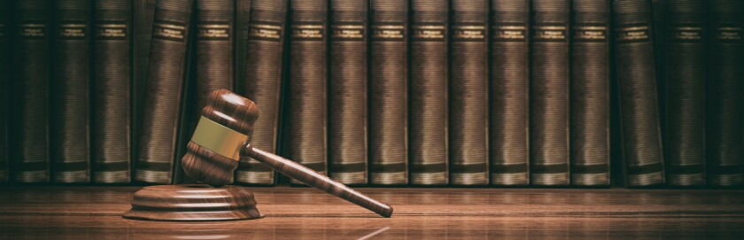 Wooden judge gavel and law books. 3d illustration