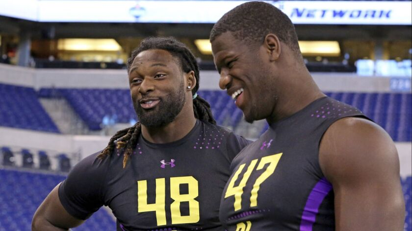 Florida State defensive lineman Josh Sweat, left, and North Carolina State defensive lineman Kentavius Street at the 2018 NFL Scouting Combine.