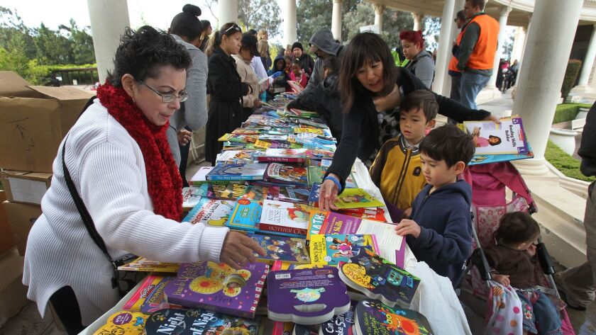 Roosevelt Brown's 2014 book giveaway party went off smoothly even though rain threatened. Tables were moved under the Spreckels Organ Pavilion promenade.