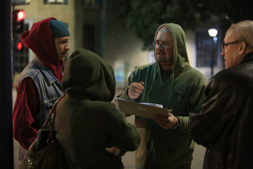 San Diego City Councilman Scott Sherman (in green hood) talks with a homeless couple on the street in downtown San Diego as part of the annual WeALLCount event. WeAllCount is an annual homeless count from 4 a.m. to 8 a.m. to get snapshot of how many homeless are in San Diego and who they are.