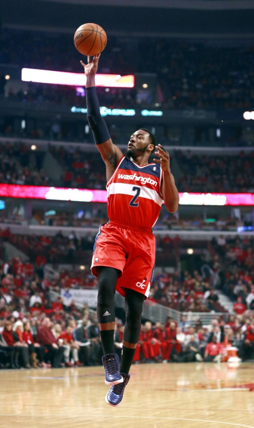 Washington Wizards guard John Wall shoots during the first half of Game 5 in an opening-round NBA basketball playoff series against the Chicago Bulls, Tuesday, April 29, 2014, in Chicago. (AP Photo/Charles Rex Arbogast)