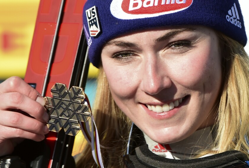 United States' Mikaela Shiffrin shows her bronze medal in the women's super-G, at the alpine ski World Championships, in Cortina d'Ampezzo, Italy, Thursday, Feb. 11, 2021. (AP Photo/Marco Tacca)