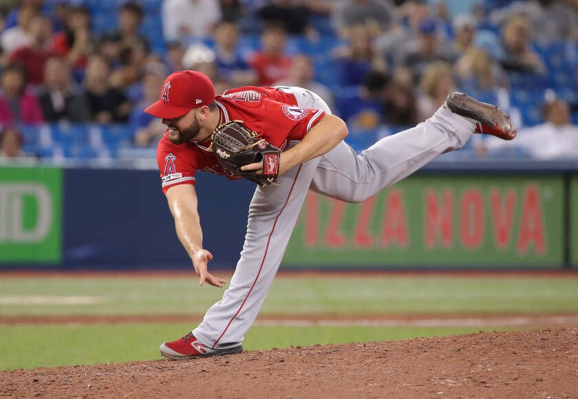 Angels reliever Cam Bedrosian delivers against the Toronto Blue Jays on June 19.