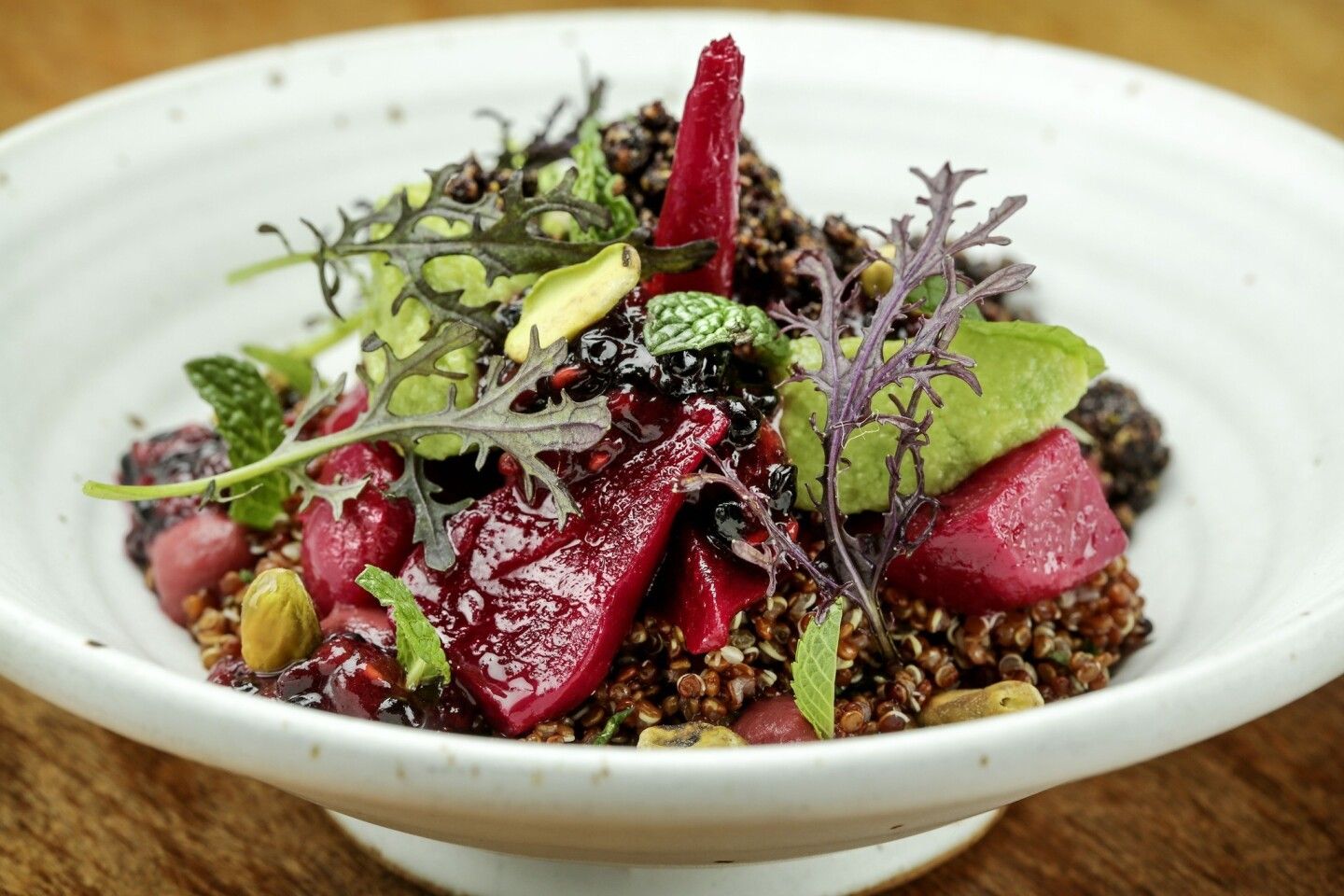 Roasted beets and purple quinoa in a rustic pottery bowl, topped with herbs, crisply roasted pistachios, chunks of buttery Reed avocado and slightly unripe mashed berries. Rustic Canyon's menu reaches higher under chef Jeremy Fox.