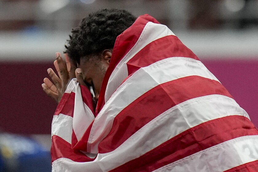 U.S. sprinter Noah Lyles reacts after getting bronze in the men's 200 meters at the Tokyo Olympics.