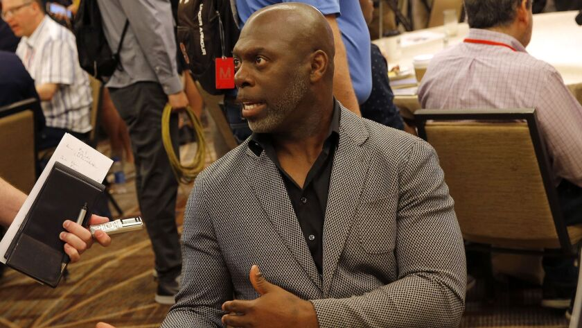 Los Angeles Chargers head coach Anthony Lynn speaks to the media during the NFC/AFC coaches breakfas