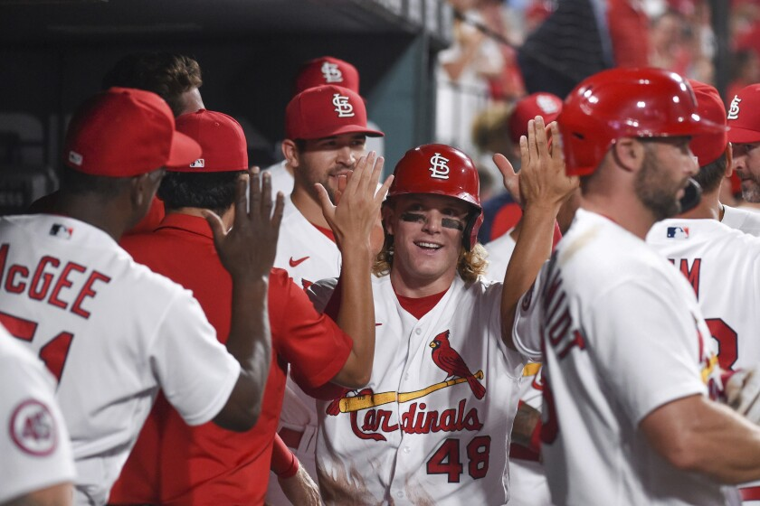 St. Louis Cardinals' Harrison Bader is congratulated after scoring a run during the sixth inning of the team's baseball game against the Minnesota Twins on Friday, July 30, 2021, in St. Louis. (AP Photo/Joe Puetz)