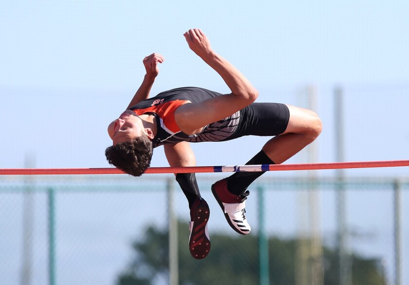 """Huntington's Jack Wiseman clears the bar at 6'-7"""" in the boys' high jump, winning the event during t"""