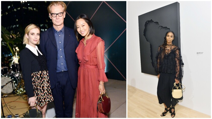 Emma Roberts, left, MOCA director Philippe Vergne, Aimee Song and Kelly Rowland (in front of a piece