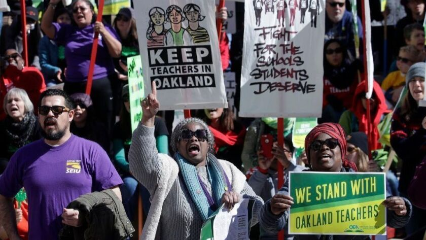 Teachers, students and supporters rally last week at Frank Ogawa Plaza in front of Oakland City Hall. School leaders and teachers reached a tentative deal Friday, ending a weeklong strike.