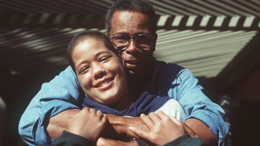 Michelle Carew, shown with her father, Rod, died in 1996 at age 18.