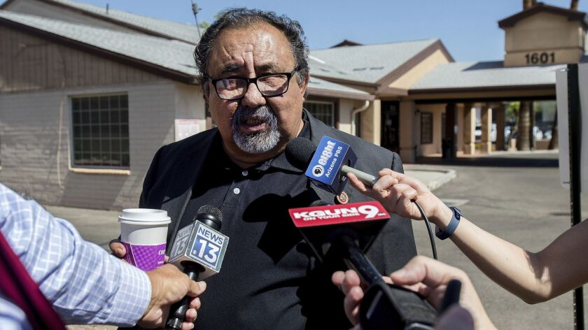 FILE- In this July 6, 2018, file photo, U.S Rep. Raul Grijalva, D-Tucson, speaks with reporters befo