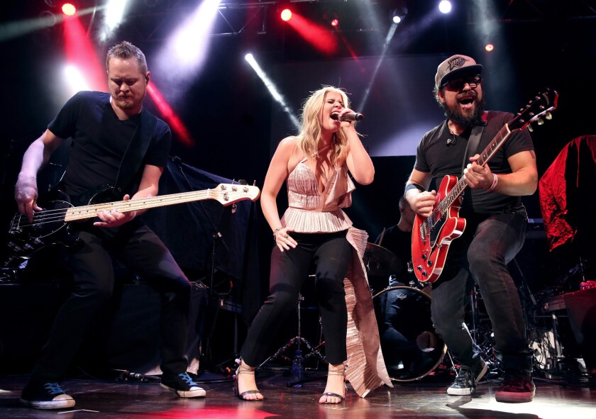 Singer-songwriter Lauren Alaina (center) will perform at the San Diego County Fair on June 2. (Christopher Polk/Getty Images for ACM)