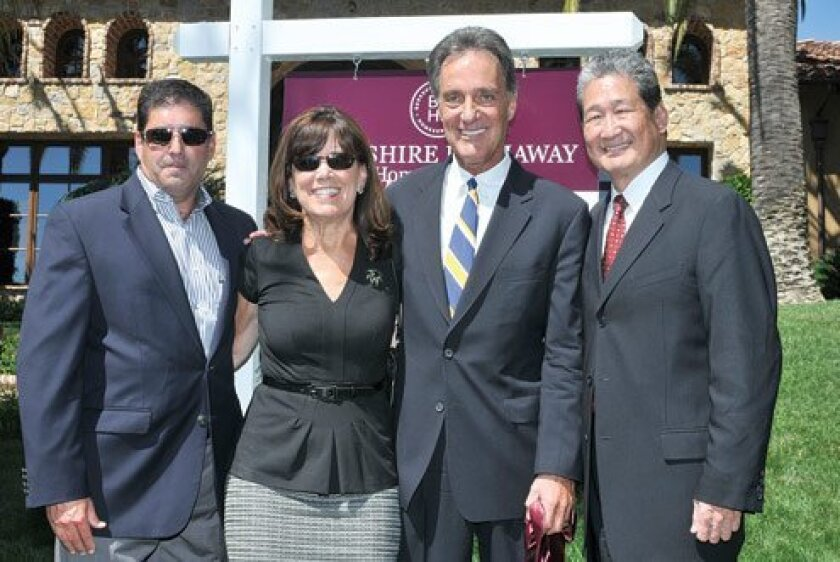 Todd Bloom and Jeannie Gleeson of the La Jolla office with David Cabott (president/CEO of Berkshire Hathaway HomeServices California Properties) and Earl Lee Credit. Photos by McKenzie Images