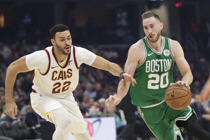 Boston Celtics' Gordon Hayward (20) drives past Cleveland Cavaliers' Larry Nance Jr. (22) in the first half of an NBA basketball game, Tuesday, Nov. 5, 2019, in Cleveland. (AP Photo/Tony Dejak)