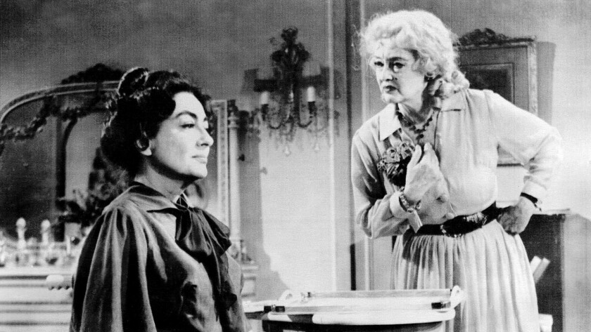 "Joan Crawford, left, and Bette Davis appear in a scene from ""What Ever Happened to Baby Jane?"" in 1962."