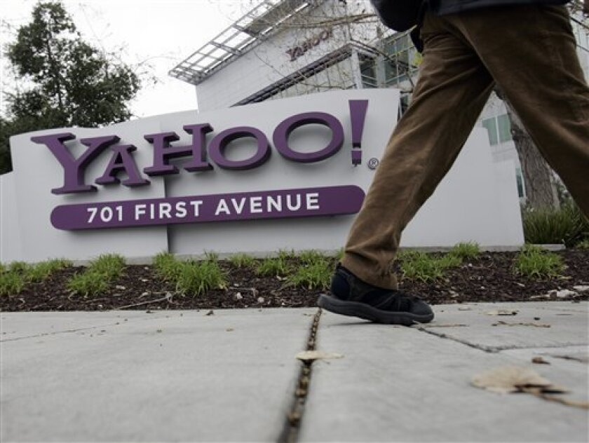 FILE - This Jan. 29, 2008 file photo shows a Yahoo worker walking into Yahoo headquarters in Sunnyvale, Calif. As  Marissa Mayer goes about her CEO business of saving Yahoo, which now involves a ban on working from home, a new study shows a significant jump in the number of U.S. employers offering