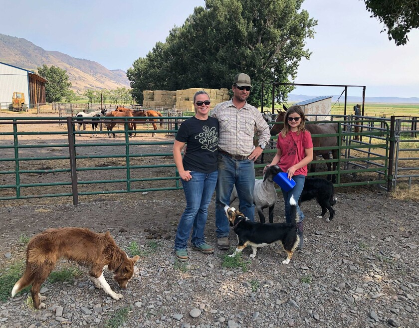 Kevin and Erica Leehmann with daughter Raelea, 10, at their ranch.