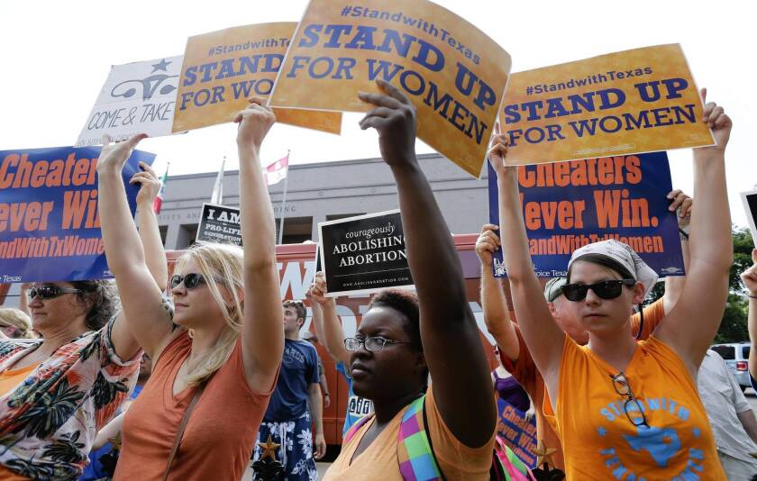 Opponents and supporters of abortion restrictions demonstrate at the Texas Capitol in Austin in July.