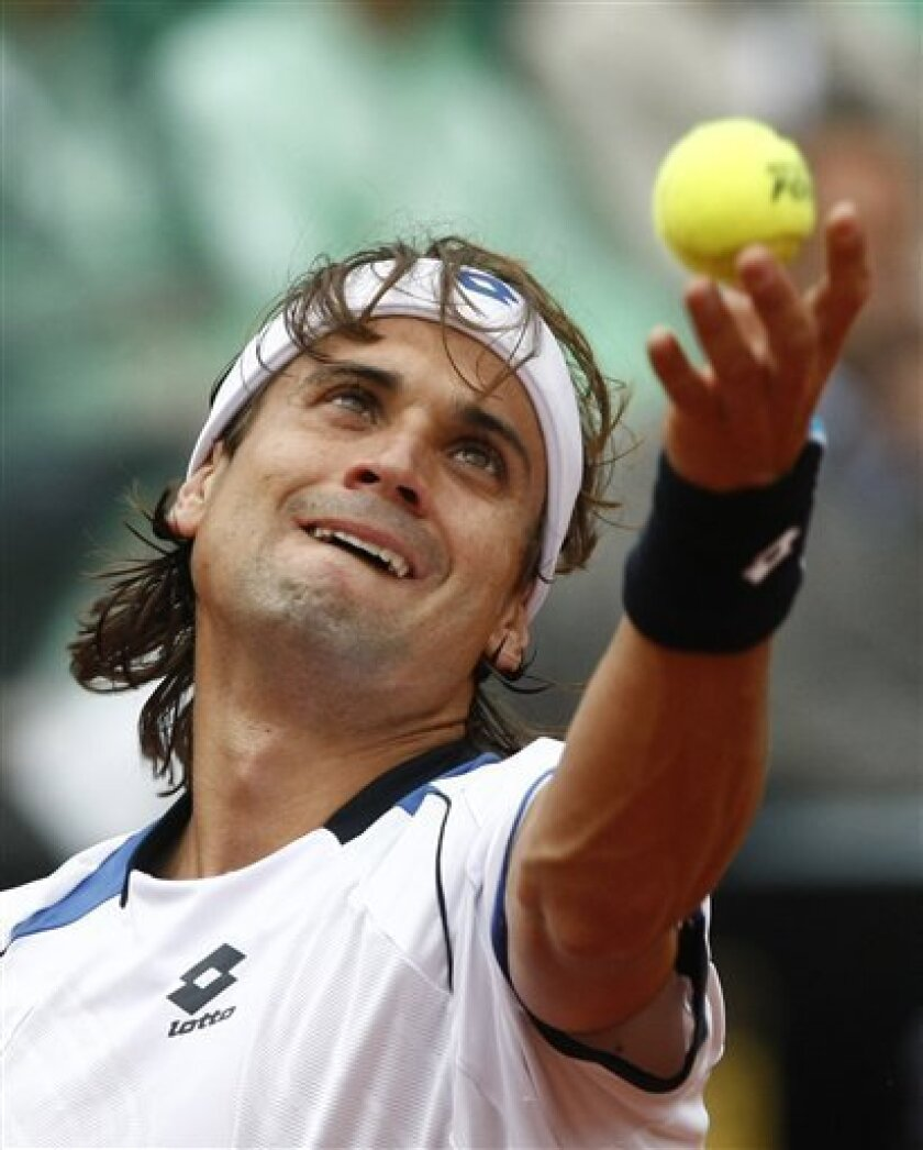 David Ferrer of Spain serves the ball to Rafael Nadal of Spain during their final match at the Rome Masters tennis tournament in Rome, Sunday, May 2, 2010. (AP Photo/Pier Paolo Cito)