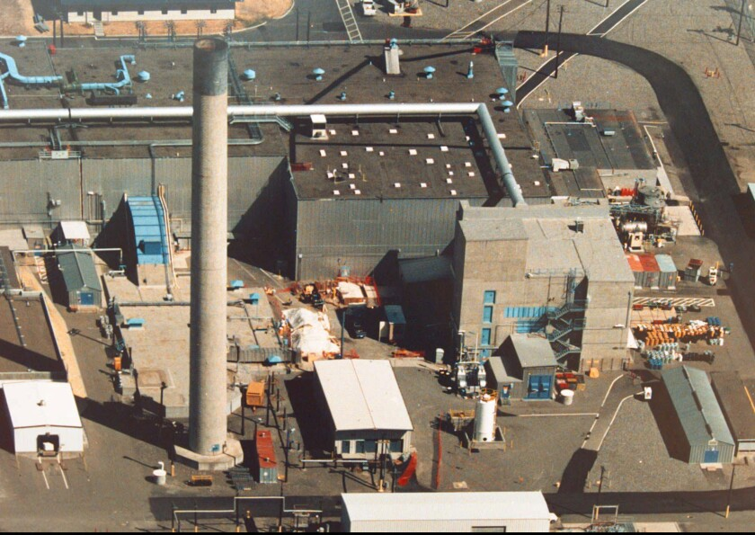 The Plutonium Reclamation Facility building at right with blue doors, on the Hanford nuclear reservation in Richland, Wash., where an explosion occurred in May 1997 is shown in this undated file photo. The building is part of the Plutonium Finishing Plant.