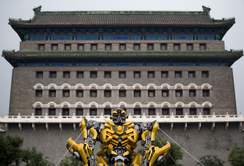 """A model of the Transformers character Bumblebee stands in front of the Qianmen Gate in Beijing to promote the movie """"Transformers: Age of Extinction."""""""