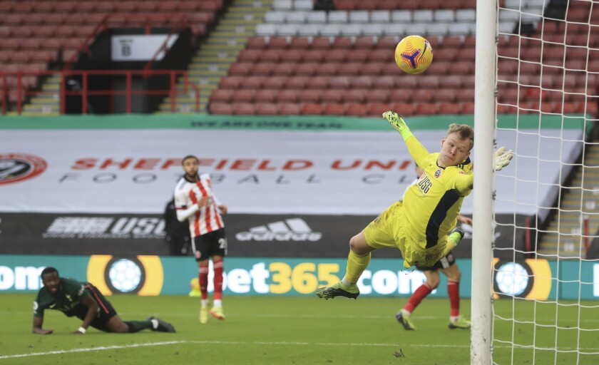 Tottenham Hotspur's Tanguy Ndombele scores his side's third goal during the English Premier League soccer match between Sheffield United and Tottenham Hotspur at the Bramall Lane stadium in Sheffield, England, Sunday, Jan.17, 2021. (Mike Egerton/Pool via AP)