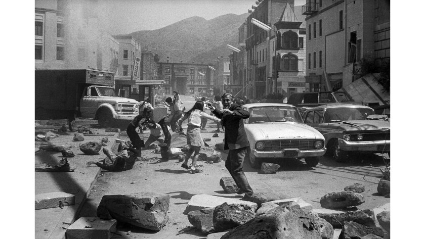 """May 3, 1974: Actors dodging rubble during filming of motion picture """"Earthquake"""" in Los Angeles, Cal"""