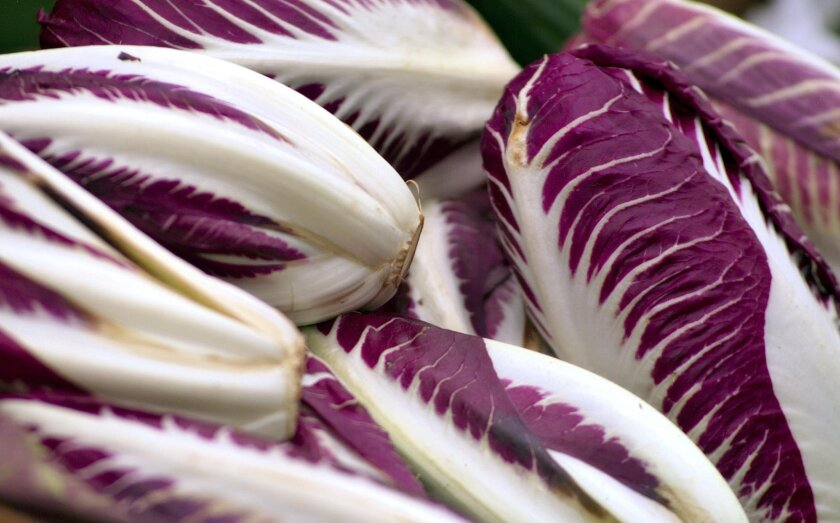 Radicchio has red and white veined leaves and a bracing, bitter flavor.