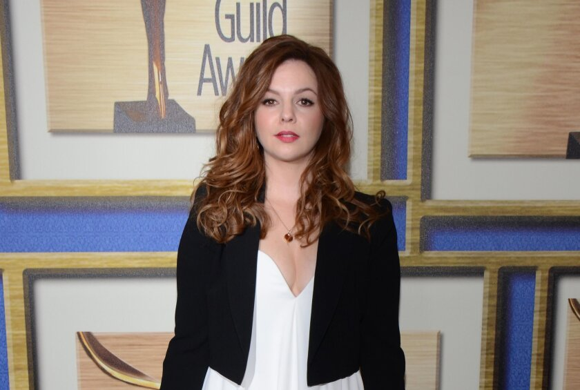 "FILE - In this Feb. 1, 2014 file photo, Amber Tamblyn arrives at the Writers Guild Awards, in Los Angeles. Tamblyn's new book of poetry called ""Dark Sparkler"" (Harper Perennial) is a downer, a magnifying glass about the way we immortalize particularly young women in Hollywood and a catalyst for web"