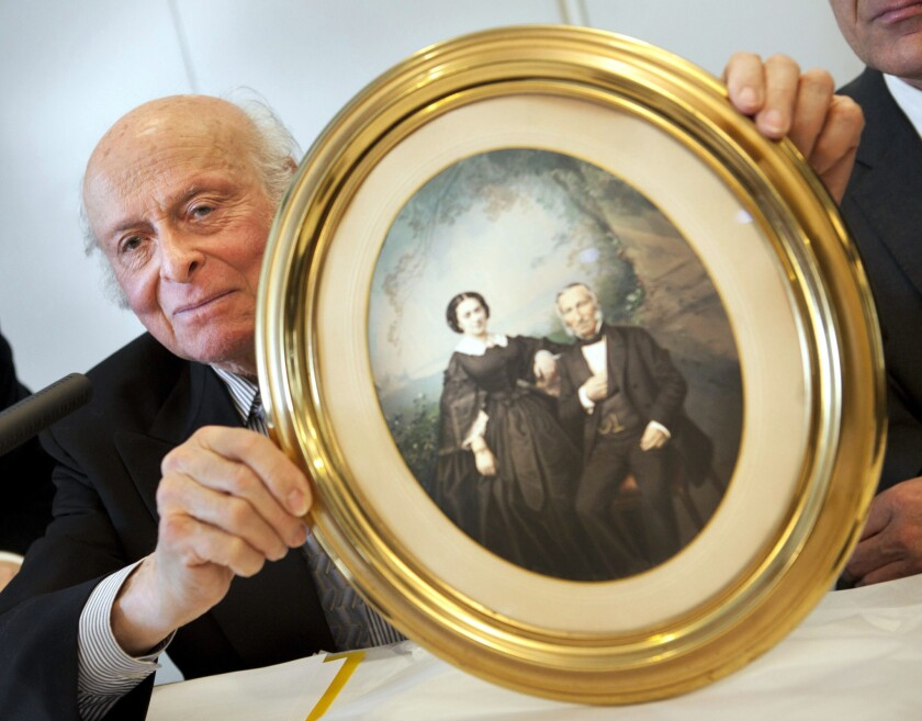 Buddy Elias, cousin of Anne Frank, holding a picture of the great-great-great grandparents of Elias and Anne Frank at the Jewish Museum in Frankfurt, Germany.