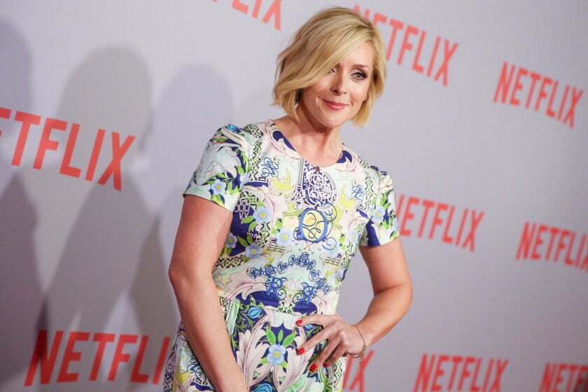 "FILE - In this June 7, 2015 file photo, Jane Krakowski arrives at Netflix's ""Unbreakable Kimmy Schmidt"" Q&A Screening at Pacific Design Center in West Hollywood, Calif. 2015 Emmy nominees all have their favorite shows, and some have imagined what it might be like to hang out in one of the alluring worlds of the small screen. ""I'm obsessed with 'The Affair.' I love 'The Affair,' but the Hamptons is pretty close..."" said Krakowski. (Photo by Rich Fury/Invision/AP, File)"