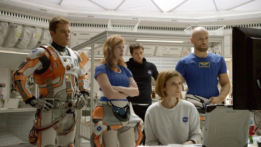 "Matt Damon, from left, Jessica Chastain, Sebastian Stan, Kate Mara and Aksel Hennie in ""The Martian."""