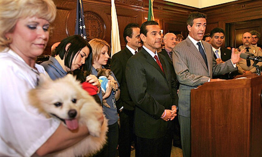 Wayne Pacelle, right, President and CEO of Humane Society of the United States at a press conference in the Mayor's Press Room where Mayor Villaraigosa was joined by Los Angeles City Councilmembers Richard Alarcón and Tony Cardenas.