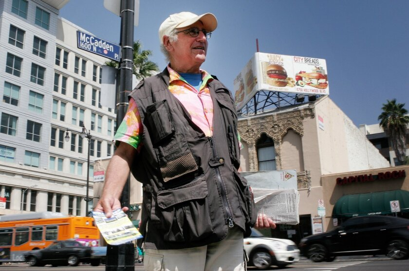 Melrose Larry Green, 62, a comedian and occasional guest on Howard Stern's radio show, peddles bus tours of celebrity homes on Hollywood Boulevard in Los Angeles on Friday, Aug. 8, 2014. Green thinks President Obama's decision to conduct airstrikes on militants in Iraq is one of political expediency, and he said removing U.S. forces from Iraq in 2011 was a mistake. On Friday, the U.S. unleashed its first airstrikes in northern Iraq against militants of the Islamic State group as a humanitarian crisis worsens.(AP Photo/Matt Hamilton)