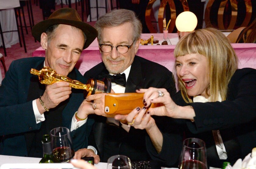 """Mark Rylance, winner of the award for best actor in a supporting role for """"Bridge of Spies"""", from left, Steven Spielberg and Kate Capshaw attend the Governors Ball after the Oscars on Sunday, Feb. 28, 2016, at the Dolby Theatre in Los Angeles. (Photo by Al Powers/Invision/AP)"""