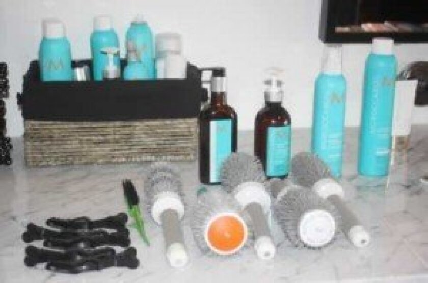 Some of the tools used for the blowout hairstyle.