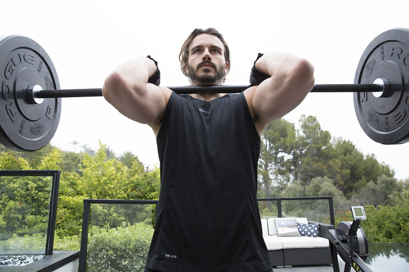 Producer Charlie Ebersol works out in the backyard of his Beverly Hills home.