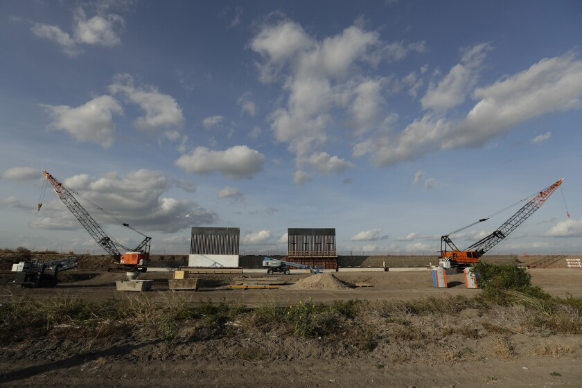 This Nov. 7, 2019 photo shows the first panels of levee border wall being put in place along the border in Donna, Texas.