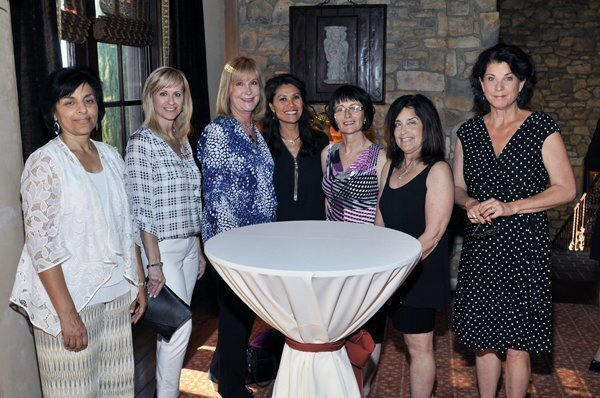 Harden-Wright & Associates achieved a top 100 national ranking in the Berkshire Hathaway Home Services of America Network. From left: Susan Joseph, Danielle Wright, Lisa Harden, BHHS Manager Delori