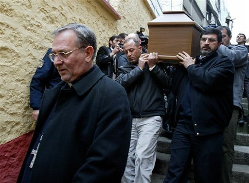 FILE - In this Feb. 6, 2006 file photo, catholic priest Luigi Padovese, left, walks in front of the coffin of his slain fellow clergyman Andrea Santoro before a memorial service in the Black Sea city of Trabzon, Turkey. Padovese, the pope's apostolic vicar in Anatolia, was stabbed to death in his home in the Mediterranean port of Iskenderun, the Anatolia news agency reported on Thursday, June 3, 2010. (AP Photo/Osman Orsal, File)
