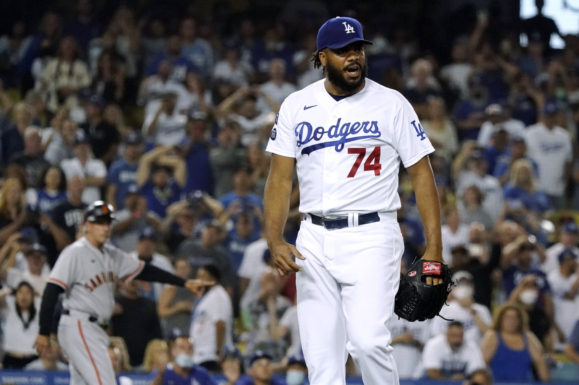 Kenley Jansen reacts after walking Darin Ruf with the bases loaded in the ninth inning.