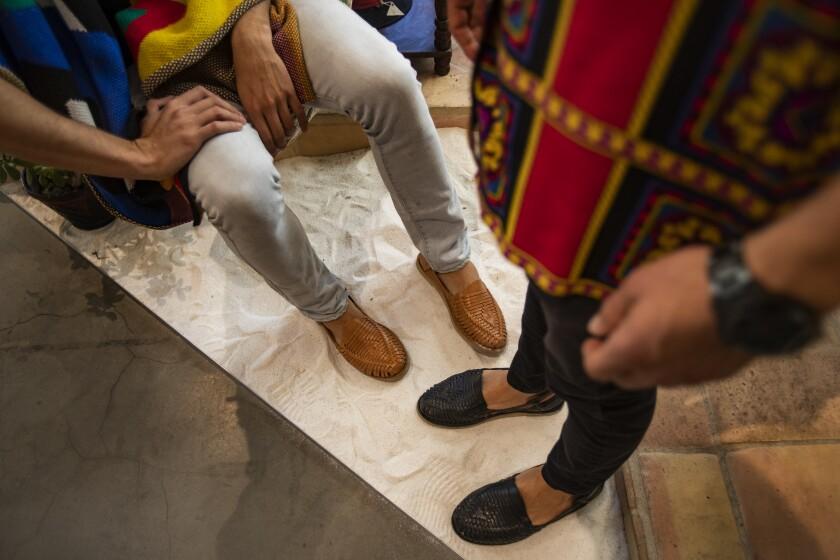 The feet of Francisco Alvarez, left, and Oscar Yapor, clad in Mexican huaraches.