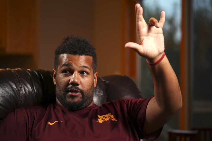 FILE - In this Sept. 5, 2016, file photo, Minnesota linebackers coach Mike Sherels talks at his home in Lakeville, Minn. Sherels has reached a $1 million settlement with the University of Minnesota Medical Center Fairview involving treatment that left him in a coma in 2016. The Minneapolis Star Tribune says the university disclosed the settlement Wednesday, Sept. 18, 2019, in response to a data request. (Jeff Wheeler/Star Tribune via AP, File)