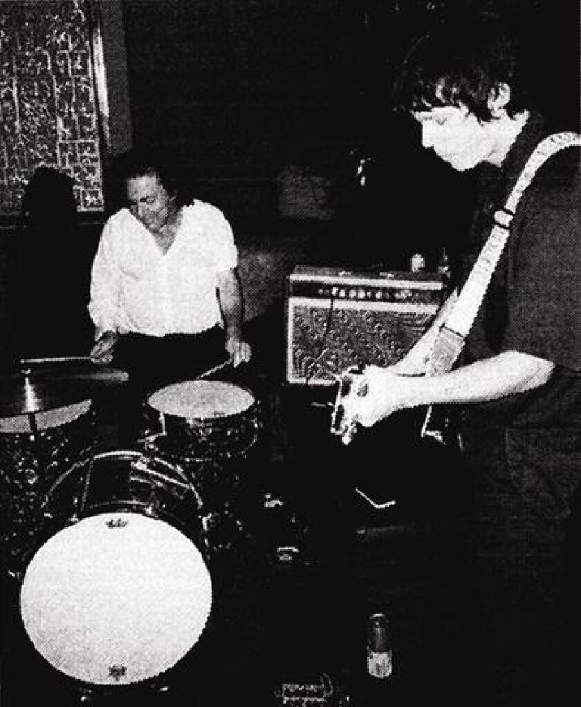 Drummer Jim White and guitarist Emmett Kelly are the Double.