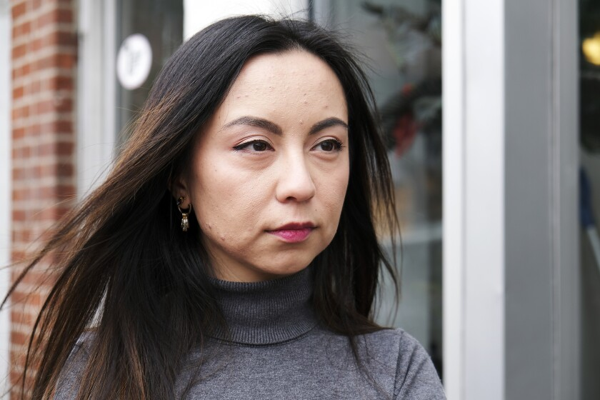 Samira Imin is photographed during an interview in Boston, Sunday, Feb. 9, 2020. It was nearly three years ago that Imin, a young Uighur Muslim woman working in Boston, last heard from her father, Iminjan Seydin, back home in China. In September she discovered that he had been kept in a government detention center, like over a million members of the beleaguered ethnic minority in China, before being sentenced to 15 years in prison in a closed trial. (Aysha Khan/RNS via AP)