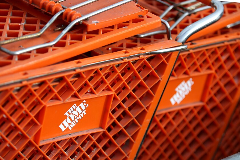Shopping carts sit in front of a Home Depot store in Daly City, California.